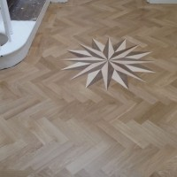 Supply and Fit Parquet Solid Oak with double bourder and Medalion 1